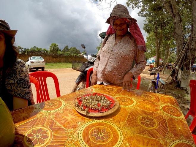 Woman Selling Amulets at Angkor