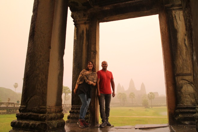 Us in the Downpour at Angkor
